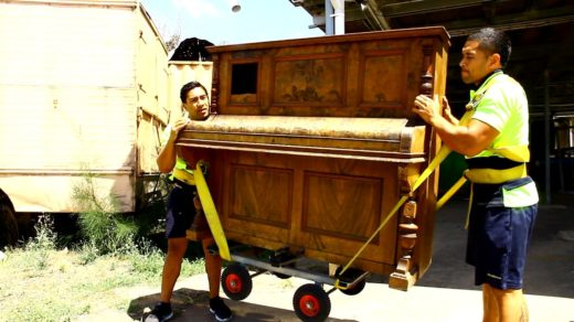 How to move a piano yourself - Two people moving an upright piano