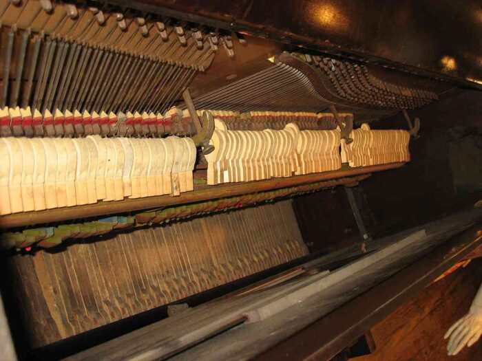 Piano with old strings (may need restringing)