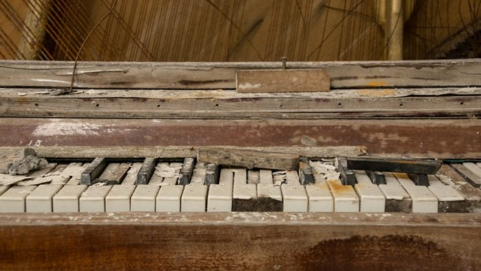 Piano Care and Cleaning Guide (image of a decrepit piano)