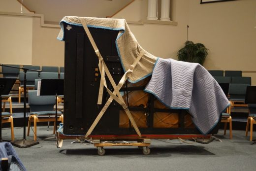 Cost to move a piano - Grand piano with blankets on a dolly