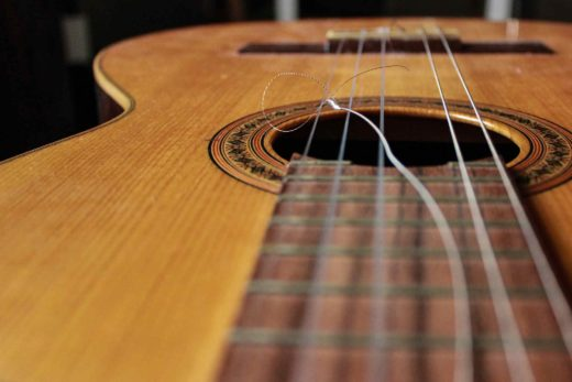 Guitar with a Broken String - Restringing a Guitar